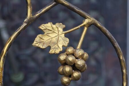 Wrought escape with a bunch of grape berries and leaves