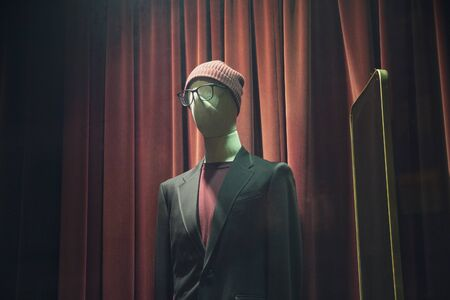 Male mannequin wearing a hat in the window
