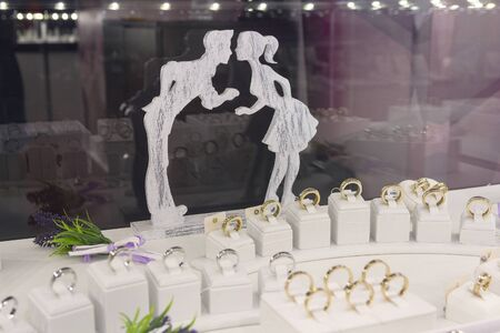 Wedding rings on the counter store. Sale Stock fotó