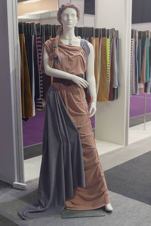 Female mannequin in an elegant dress in a clothing store. Fashion 写真素材 - 143436411