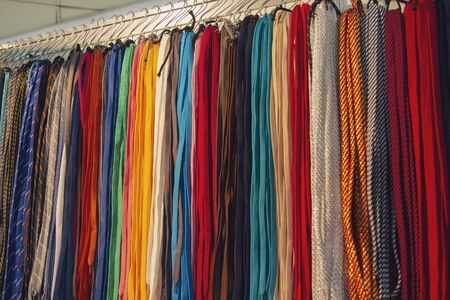 Many multi-colored laces in the storefront. Sale