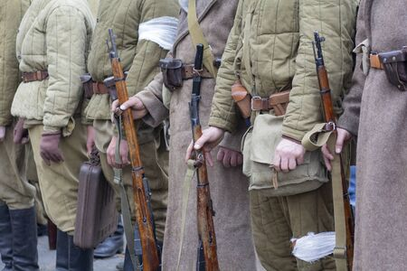 Re-enactors Dressed As Soviet Infantry Soldiers Of World War II Holds Rifles Weapons In Hands Stock Photo