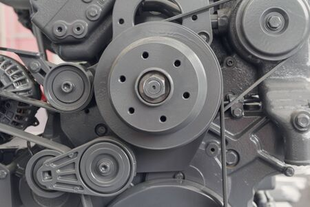 Car engine part close up. Industrial background