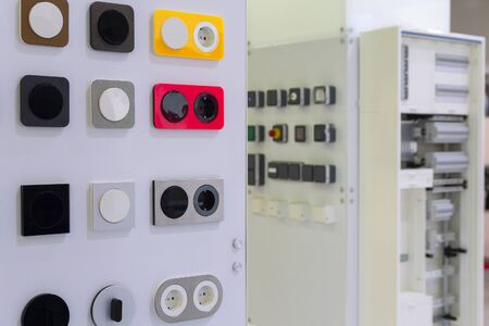 Electrical household switches and sockets on the stand in the store