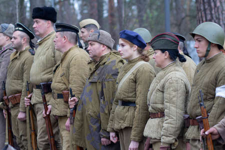 Vorzel, Ukraine - May 9, 2018: People in the form of Red Army soldiers stand in formation with weapons on the historical reconstruction of the anniversary of the victory in World War II Editorial