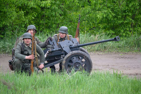 Kiev, Ukraine - May 09, 2019: Wehrmacht soldiers with anti-tank guns. Historical Reconstruction in an anniversary of the victory in World War II Editorial