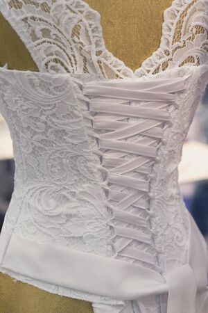 Parts of wedding dress with corset and fabric