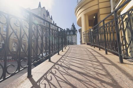 Buildings in the classical style and railings in the foreground. Architecture