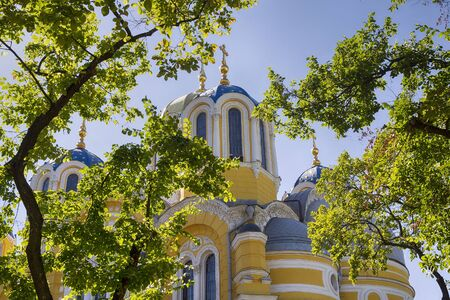 Orthodox Church and the branches of a tree against the blue sky. Kiev, Ukraine