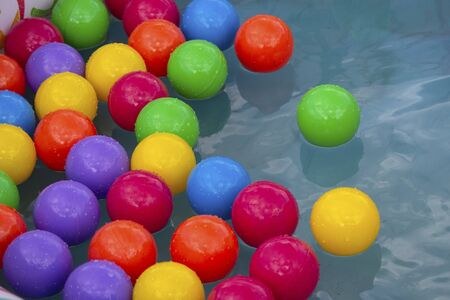 Colorful plastic balls in a pool. Games