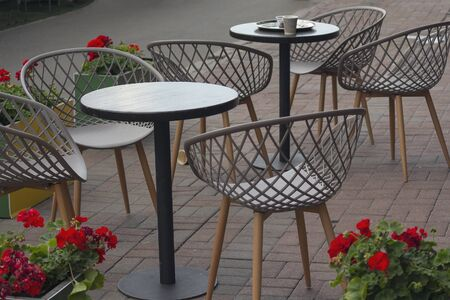 Tables and chairs of street cafe without people. City Foto de archivo