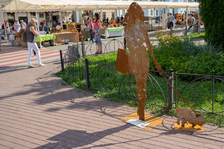 Kiev, Ukraine - July 13, 2018: Installation made of metal shot through the zone of the antiterrorist operation in the town square with the words