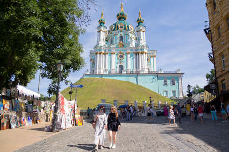 Kiev, Ukraine - June 10, 2018. Andreevsky descent in Kiev - is one of the ancient ways connecting the Upper city, its central part, with the trading Podol. St. Andrew's Church