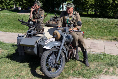 Kiev, Ukraine - May 27, 2018: Mens wearing German soldiers 'clothes on motorcycle at historical reconstruction festival