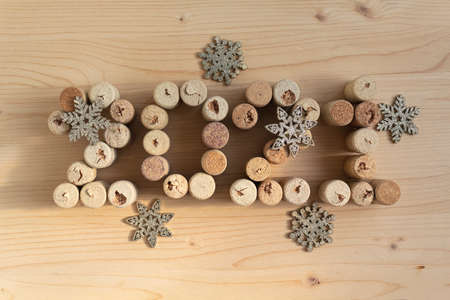 Wine corks stacked as the date of the 2020 retro style. Christmas background