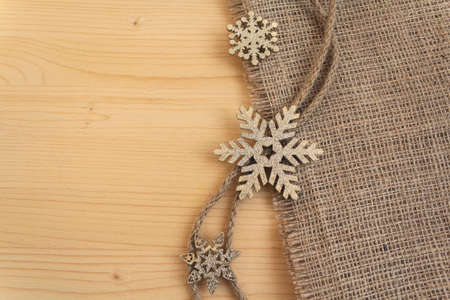 Stylized snowflakes on a wooden surface. Christmas decorations
