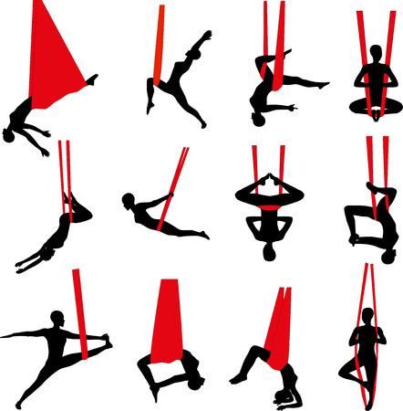 gravedad: Yoga aérea. Yoga antigravedad. Mujer que hace ejercicio de yoga contra la gravedad. Silueta. Foto de archivo