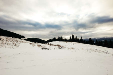 A snow covered slope in snow a mountain Stockfoto