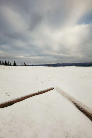 A body of water in snow a mountain