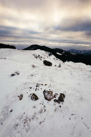 A snow covered field in snow a mountain