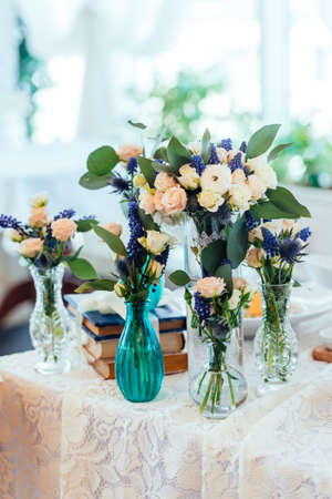 Dream And Blue Flowers In Vases On A Table With A Lace Tablecloth