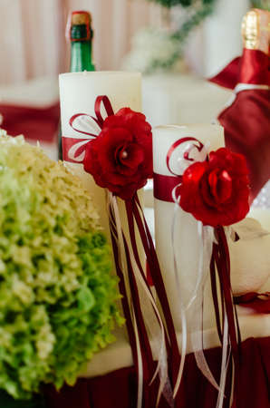 White Wedding Candles Decorated With Red Roses And Ribbons Wedding