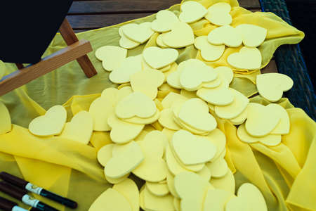 Little yellow hearts for the guests wishes. Writing wishing and congratulation to bride and groom. Wedding decoration