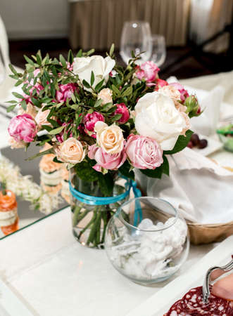 Beautiful Wedding Bouquet Of Cream And Pink Roses In Glass Vase