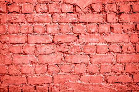 Grunge brick wall texture, copy space. Living Coral background. Color of the year 2019. Top view, flat lay