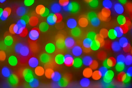 Christmas bokeh background, copy space. Defocused new year bokeh lights, free space. Blurred bokeh. Abstract holiday glitter background. Lens flare pattern