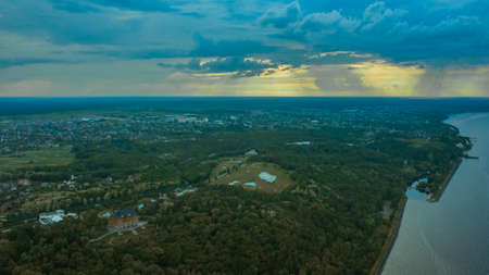 spectacular and very colorful sunset over the golf course in the private residence of Mezhyhiria and the small village of New Petrovtsy .Kyiv, Ukraine - Cityscape Aerial Flight