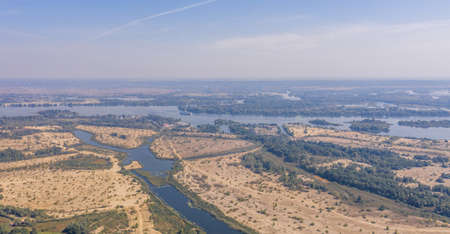 A view of a dry fields along the Dnipro River in the valley. High quality footage Фото со стока
