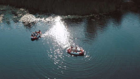 water rescue operation, a man overboard and a rescue service rescues him. The view from the helicopter Foto de archivo