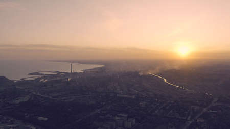 Industrial city in summer. On the horizon, a metallurgical plant near the sea. Aerial view. Mariupol, Ukraine