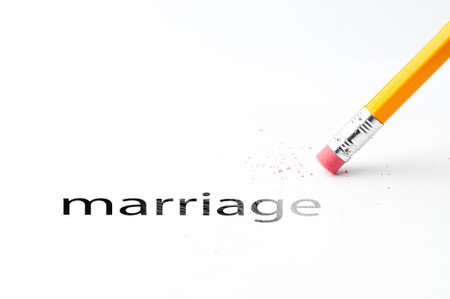 eradicate: Closeup of pencil eraser and black marriage text. Pencil with eraser. Yellow pencil.