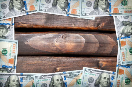 grange: Denominations of American hundred dollar bills on a background of old boards. American dollar. Grange background.