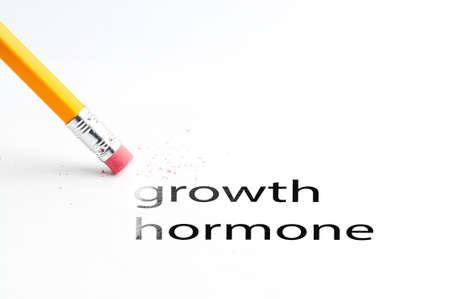 oxidative: Closeup of pencil eraser and black growth hormone text. Growth hormone. Pencil with eraser. Gh.