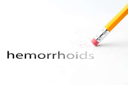 incontinence: Closeup of pencil eraser and black hemorrhoids text. hemorrhoids. Pencil with eraser.
