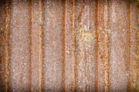 Rusty metal background. Background texture of old rusty metal sheet. Grunge background. photo