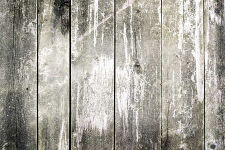 Old board. Old cracked board long lain outdoors. Background of wood. Stock Photo