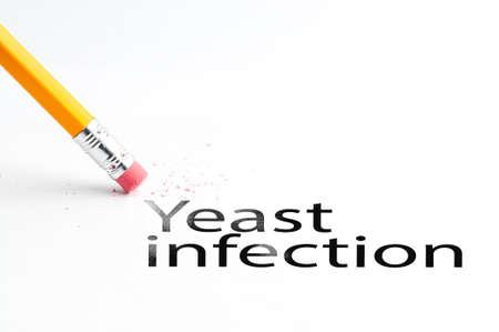 Closeup of pencil eraser and black yeast infection text. Yeast infection. Pencil with eraser. Imagens