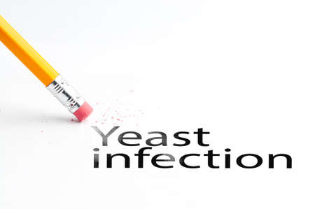 Closeup of pencil eraser and black yeast infection text. Yeast infection. Pencil with eraser.