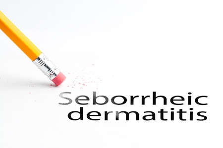 incontinence: Closeup of pencil eraser and black seborrheic dermatitis text. Seborrheic dermatitis. Pencil with eraser. Stock Photo