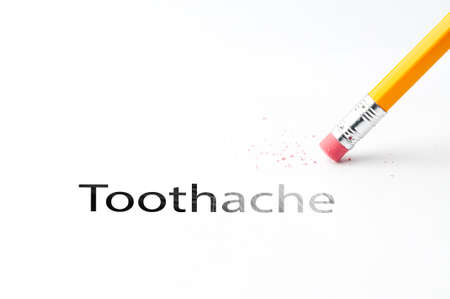 ms: Closeup of pencil eraser and black toothache text. Toothache. Pencil with eraser.