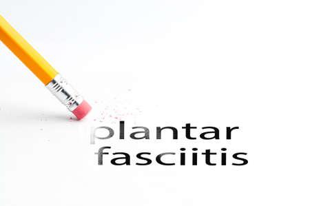 plantar: Closeup of pencil eraser and black plantar fasciitis text. Plantar fasciitis. Pencil with eraser.