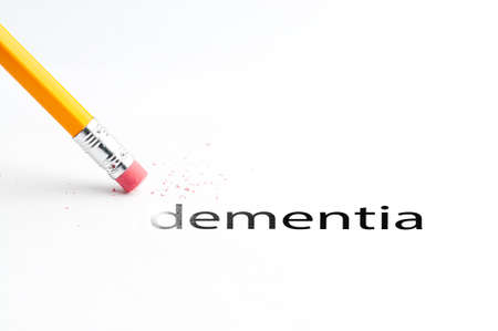 incontinence: Closeup of pencil eraser and black dementia text. Dementia. Pencil with eraser. Stock Photo