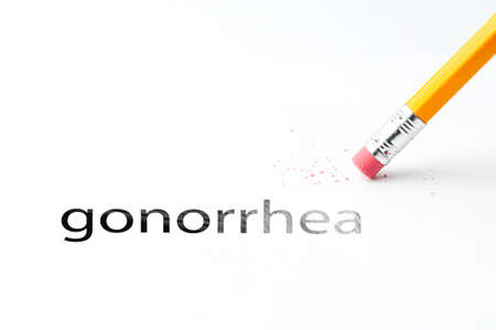 incontinence: Closeup of pencil eraser and black gonorrhea text. Gonorrhea. Pencil with eraser.