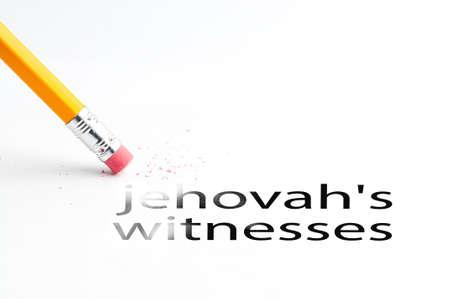 Closeup of pencil eraser and black jehovahs witnesses text. Jehovahs witnesses. Pencil with eraser. Stock Photo