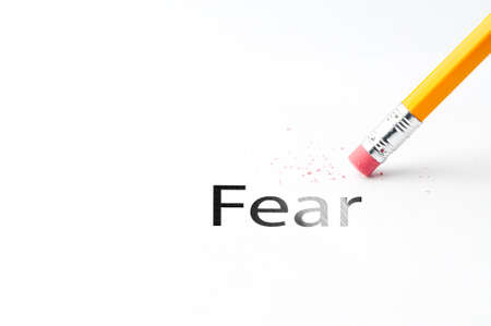 fear: Closeup of pencil eraser and black fear text. Fear. Pencil with eraser.