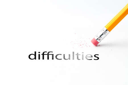 pencil eraser: Closeup of pencil eraser and black difficulties text. Difficulties. Pencil with eraser. Stock Photo